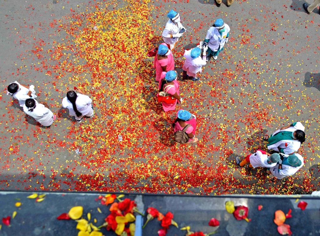 Medics and Asha workers being showered with flower petals on the orders of DCM Lakshman Savadi, to honour them for their contribution in the fight against COVID-19 at Majestic Bus Stand in ...