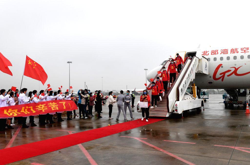 Medics supporting virus-hit Hubei Province disembark from the plane at Nanning Wuxu International Airport in Nanning, south China's Guangxi Zhuang Autonomous ...