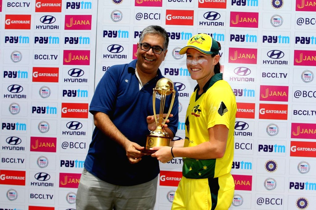 Megan Schutt of Australia receives the player of the series during post match presentation ceremony after winning the final of the women's tri-series between Australia and England at the ...