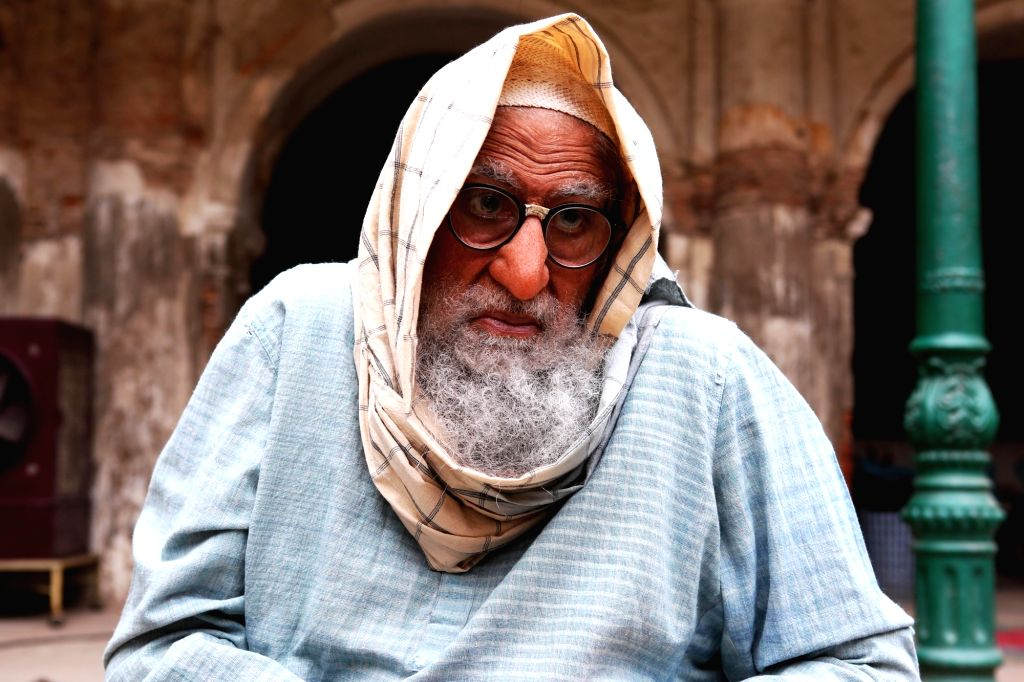 """Megastar Amitabh Bachchan's first look from the upcoming film """"Gulabo Sitabo"""" is out and he is sporting a grumpy old man's look. In the first look doing the rounds on social media, the 76-year-old thespian is seen sporting a long beard, spectacles, a - Megastar Amitabh Bachchan"""