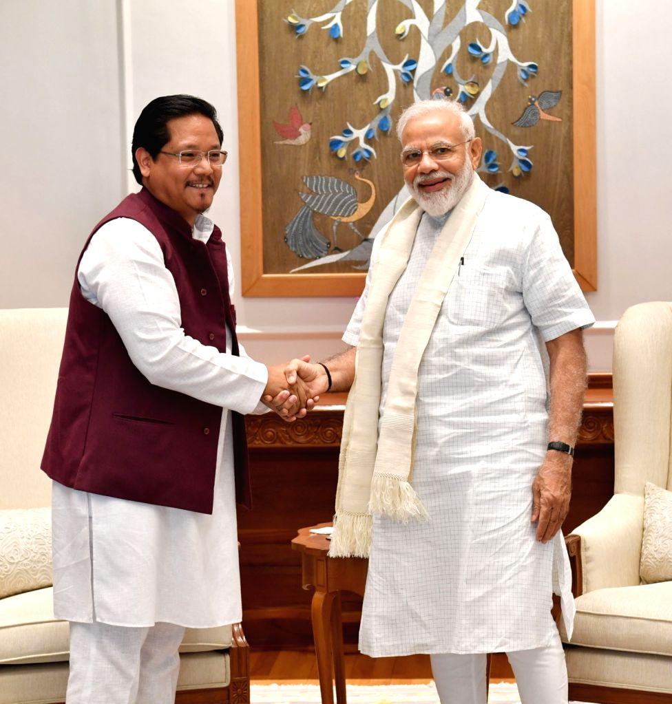 Meghalaya Chief Minister Conrad Sangma meets Prime Minister Narendra Modi, in New Delhi on June 15, 2019. - Conrad Sangma and Narendra Modi