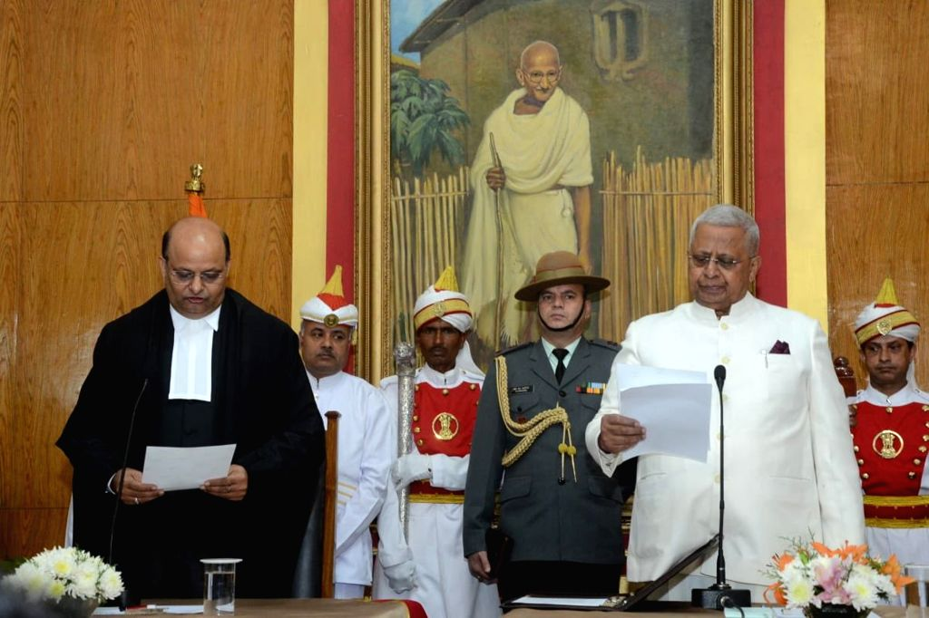 Meghalaya Governor Tathagata Roy administers the oath of office to Justice Mohammed Rafiq as the new Chief Justice of the Meghalaya High Court at a swearing-in ceremony at Raj Bhavan in ... - Tathagata Roy
