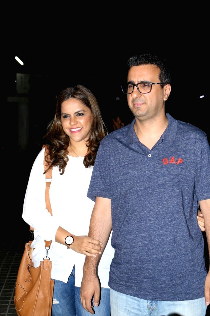 Meghna Ghai Puri, President, Whistling Woods International with husband Rahul Puri during the screening of film Badrinath Ki Dulhania in Mumbai on March 9, 2017.