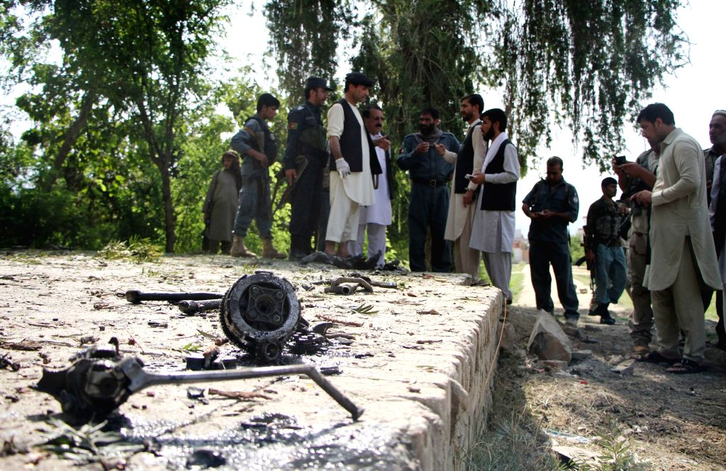MEHTARLAM, Aug. 4, 2016 - Afghan security force members inspect the site of a blast in Mehtarlam, capital of Laghman province, Afghanistan, Aug. 4, 2016. One person was killed and five others wounded ...