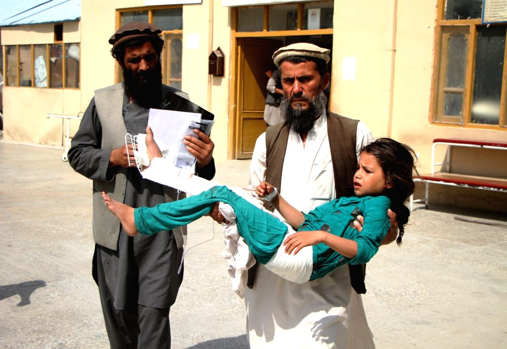 MEHTARLAM, Aug. 4, 2016 - An Afghan man carries an injured child to a hospital after a blast in Mehtarlam, capital of Laghman province, Afghanistan, Aug. 4, 2016. One person was killed and five ...