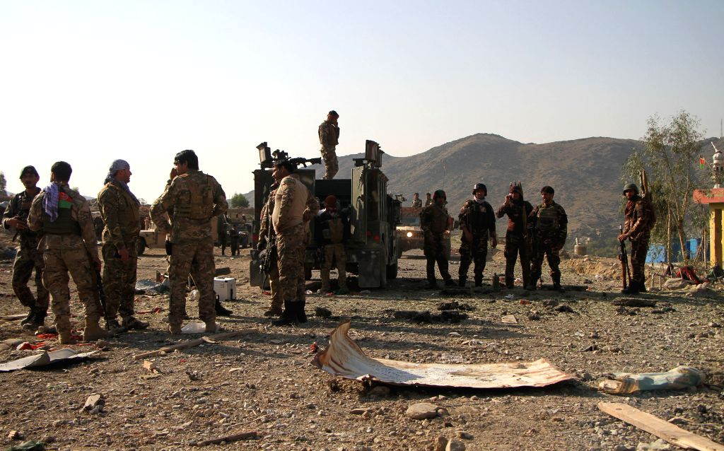 MEHTARLAM, Oct. 16, 2019 - Afghan security force members inspect the site of a car bomb in Alishing district in Laghman province, Afghanistan, Oct. 16, 2019. Two police officers and a civilian were ...