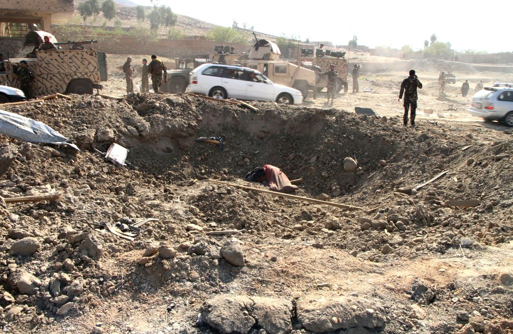 MEHTARLAM, Oct. 16, 2019 - Photo taken on Oct. 16, 2019 shows the site of a car bomb in Alishing district in Laghman province, Afghanistan. Two police officers and a civilian were killed and 43 ...