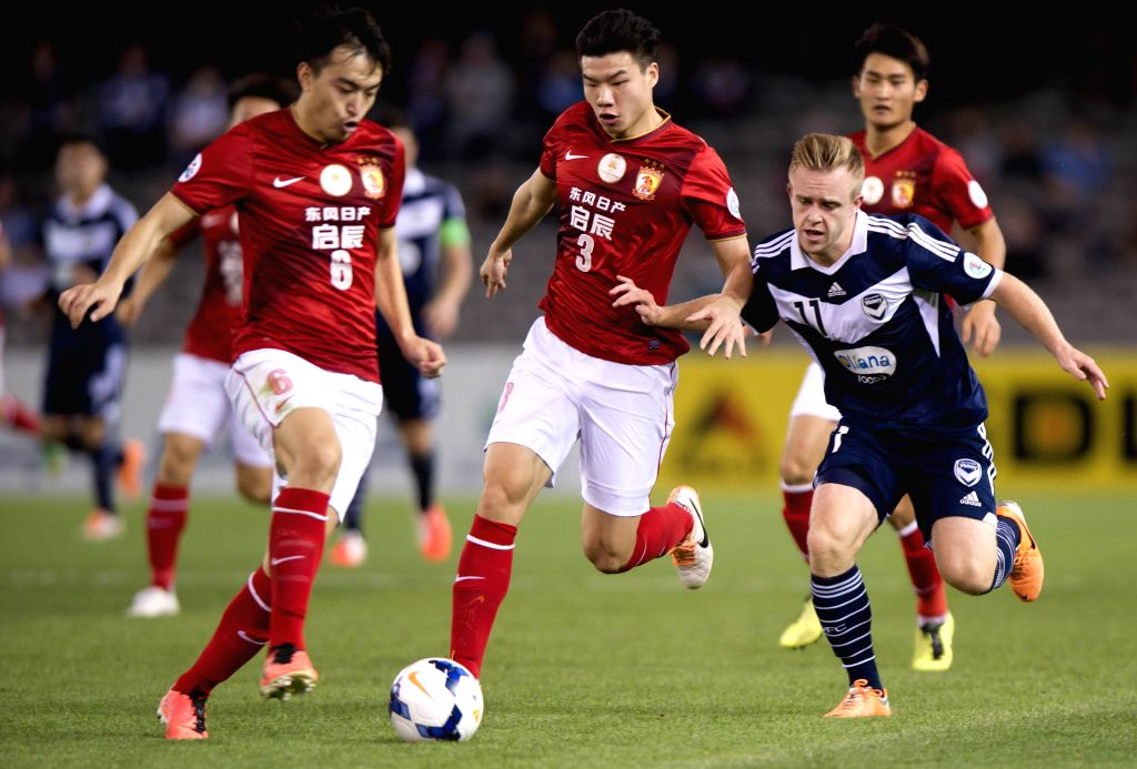 Feng Xiaoting (L) and Mei Fang (C) of Guangzhou Evergrande compete during the AFC Champions League against Melbourne Victory at Etihad Stadium in Melbourne, ...