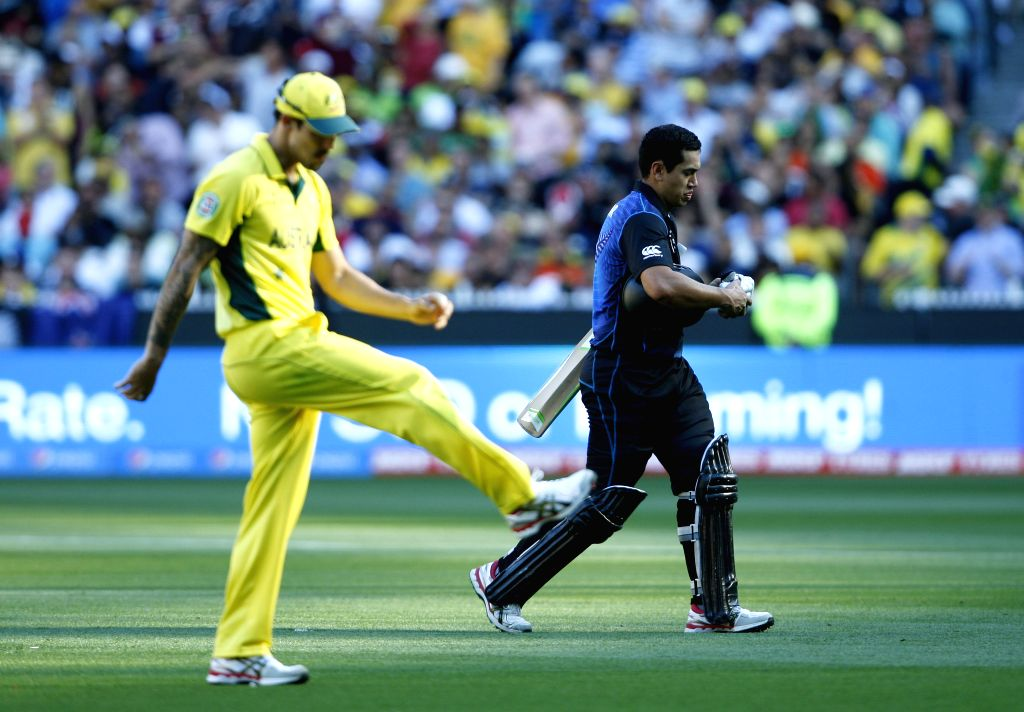 Melbourne (Australia): Ross Taylor of New Zealand returns back to the pavalion after being dismissed during the  final match of ICC World Cup 2015 between Australia and New Zealand at Melbourne ...