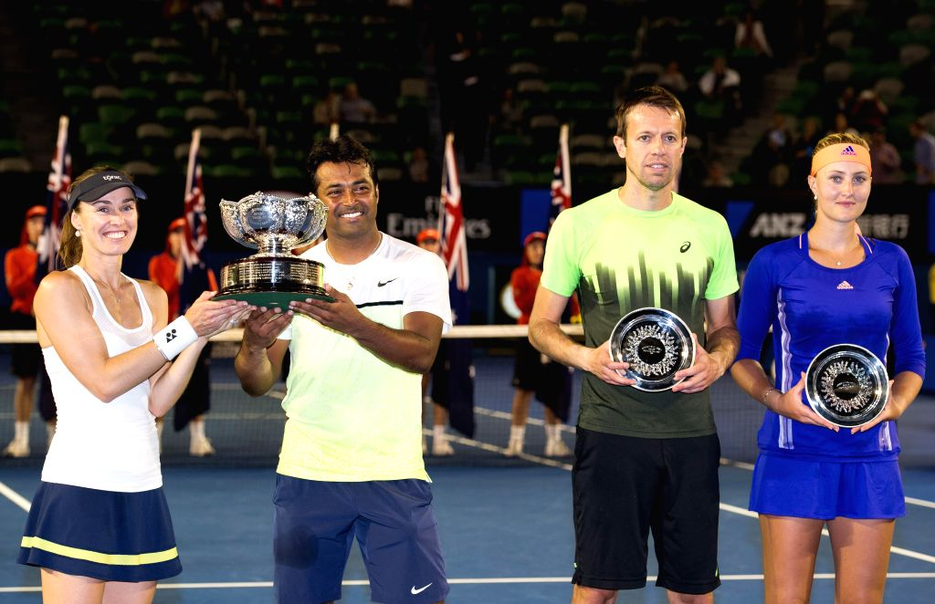 (from L to R) Martina Hingis of Switzerland, Leander Paes of India, Daniel Nestor of Canada, Kristina Mladenovic of France show their trophies after mixed doubles . - Martina Hingis