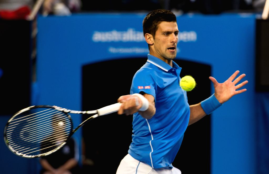 Novak Djokovic of Serbia returns the ball during his men's singles final match against Andy Murray of Great Britain at 2015 Australian Open tennis tournament at ...