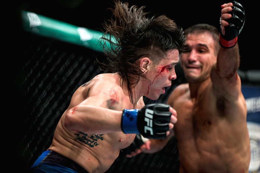 MELBOURNE, Feb. 10, 2019 - Ricky Simon (L) of the United States competes during the bantamweight bout at the UFC 234 event between Ricky Simon of the United States and Rani Yahya of Brazil in ...