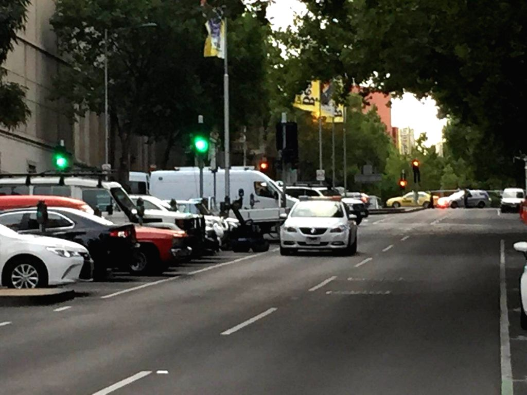 MELBOURNE, Feb. 15, 2018 - Photo taken by cellphone shows a robot sent by the police trying to defuse a suspicious package in downtown Melbourne, Australia, Feb. 15, 2018.