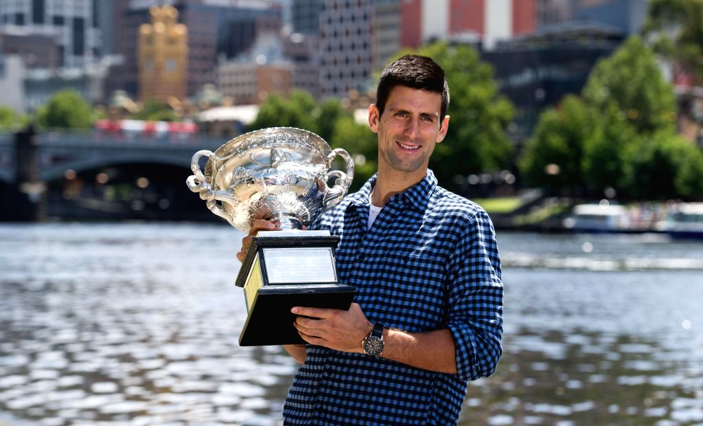 Champion of 2015 Australian Open men's singles Novak Djokovic poses for a photo with the Norman Brookes Challenge Cup in Melbourne, Australia, Feb. 2, 2015. ...