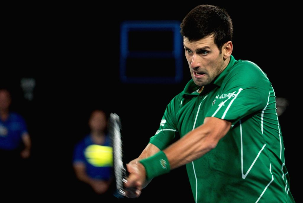 MELBOURNE, Feb. 2, 2020 (Xinhua) -- Novak Djokovic of Serbia returns the ball during the men's singles final against Dominic Thiem of Austria at 2020 Australian Open in Melbourne, Australia on Feb. 2, 2020. (Xinhua/Zhu Hongye/IANS)