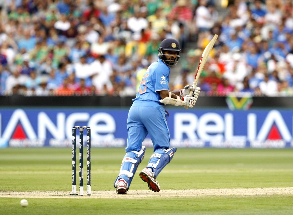 Indian cricketer Shikhar Dhawan in action during an ICC World Cup 2015 match between India and South Africa at Melbourne Cricket Ground, Australia on Feb 22, 2015. - Shikhar Dhawan