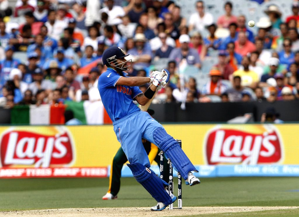 Indian cricketer Virat Kohli in action during an ICC World Cup 2015 match between India and South Africa at Melbourne Cricket Ground, Australia on Feb 22, 2015. - Virat Kohli