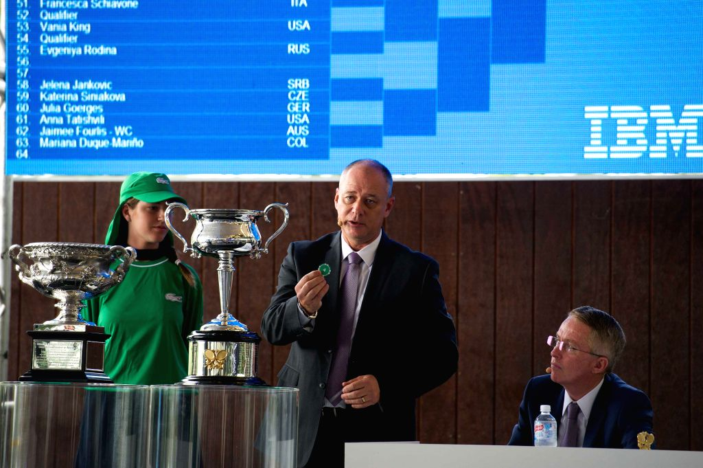 MELBOURNE, Jan. 13, 2017 - Australian Open Referee Wayne McEwen (C) and Tournament Director Craig Tiley (R) along with a ballkid draw for Australian Open 2017 at Melbourne Park in Melbourne, ...