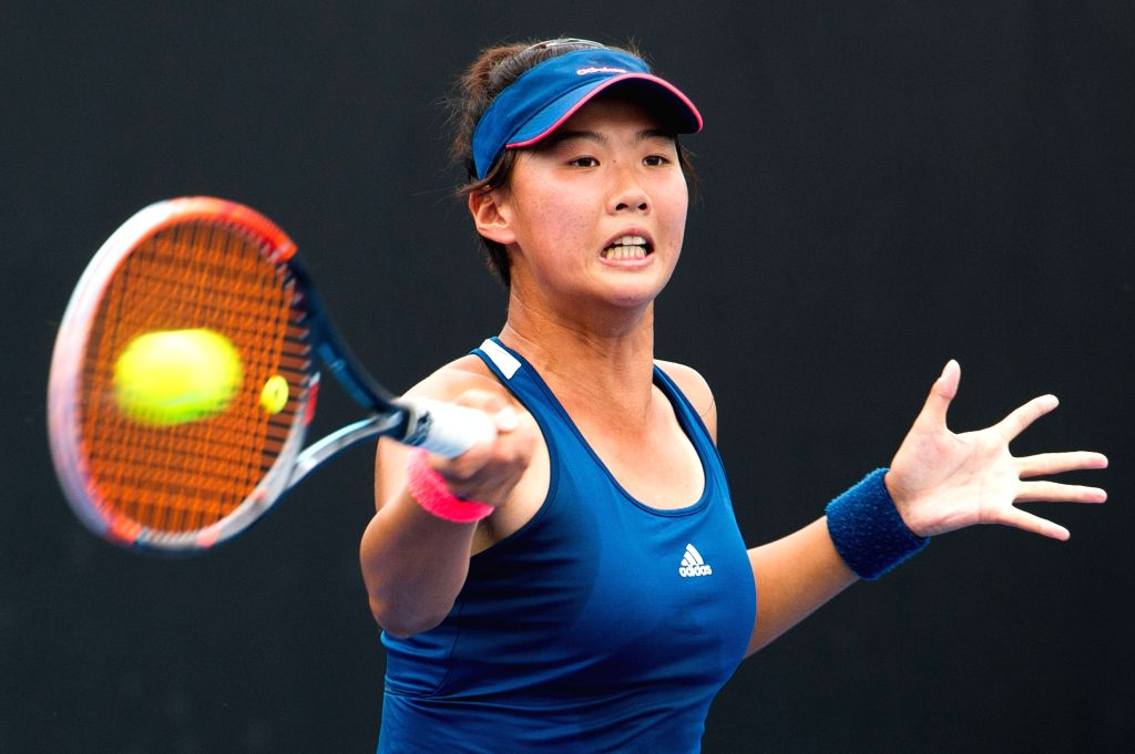 MELBOURNE, Jan. 13, 2017 - Liu Fangzhou of China hits the ball against Aryna Sabalenka of Belarus during the women's singles second round of Australian Open 2017 qualifying match at Melbourne Park in ...