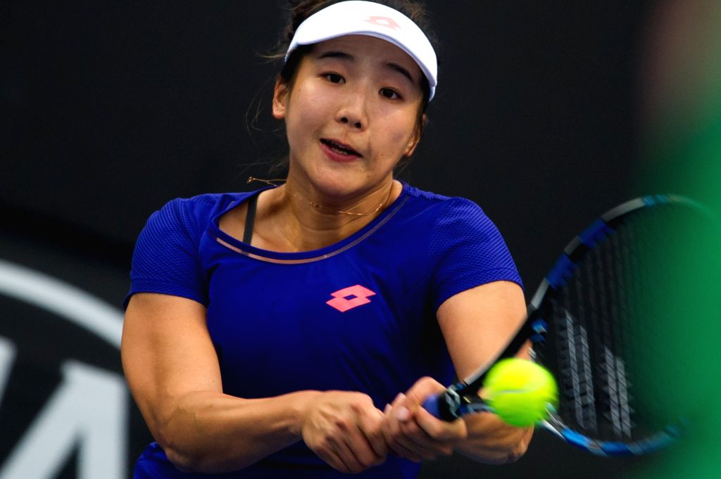 MELBOURNE, Jan. 13, 2017 - Zhang Kailin of China hits the ball against Barbora Krejcikova of the Czech Republic during the women's singles second round of Australian Open 2017 qualifying match at ...