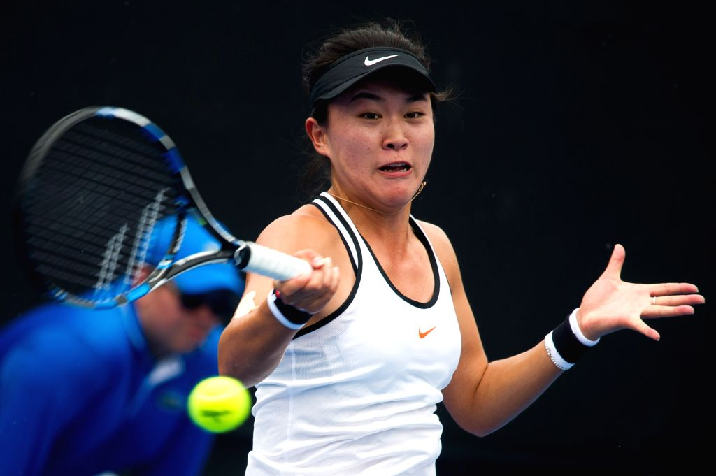 MELBOURNE, Jan. 13, 2017 - Zhu Lin of China hits the ball against Jennifer Elie of the United States during the women's singles second round of Australian Open 2017 qualifying match at Melbourne Park ...