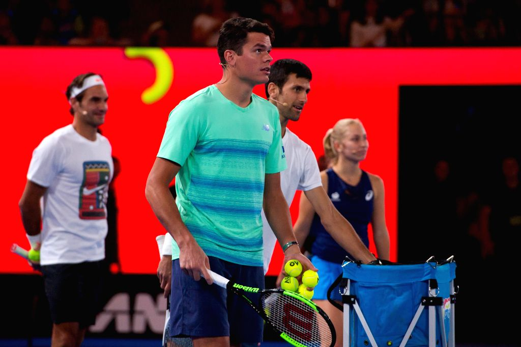 MELBOURNE, Jan. 14, 2017 - Milos Raonic (front) of Canada attends an exhibition match at Melbourne Park in Melbourne, Australia, Jan. 14, 2017. An exhibition match on Kids Tennis Day was held ahead ...