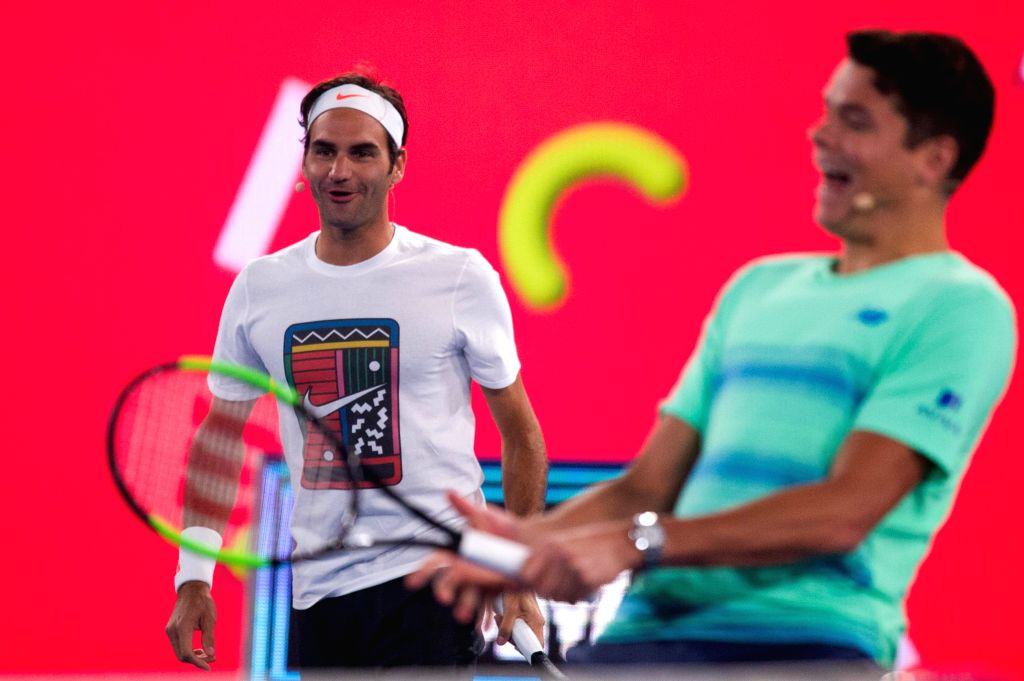 MELBOURNE, Jan. 14, 2017 - Roger Federer (L) of Switzerland attends an exhibition match at Melbourne Park in Melbourne, Australia, Jan. 14, 2017. An exhibition match on Kids Tennis Day was held ahead ...