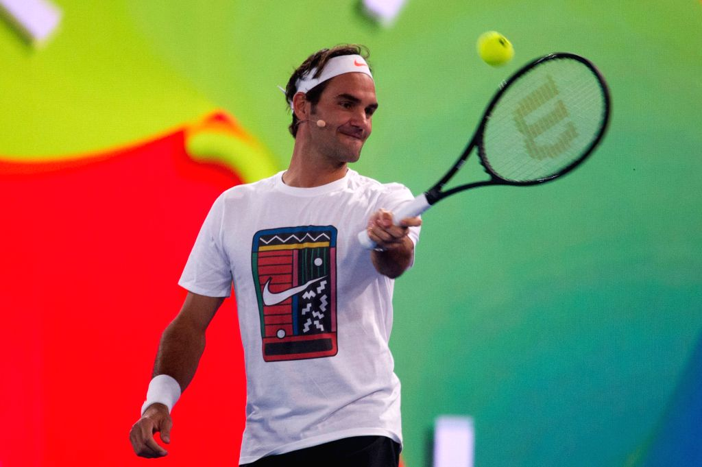 MELBOURNE, Jan. 14, 2017 - Roger Federer of Switzerland hits the ball during an exhibition match at Melbourne Park in Melbourne, Australia, Jan. 14, 2017. An exhibition match on Kids Tennis Day was ...
