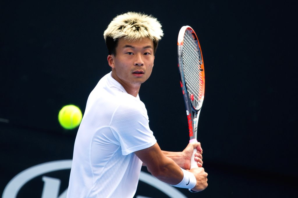 MELBOURNE, Jan. 14, 2017 - Wu Di of China hits the ball during the men's singles third round of Australian Open 2017 qualifying match against Ivan Dodig of Croatia at Melbourne Park in Melbourne, ...