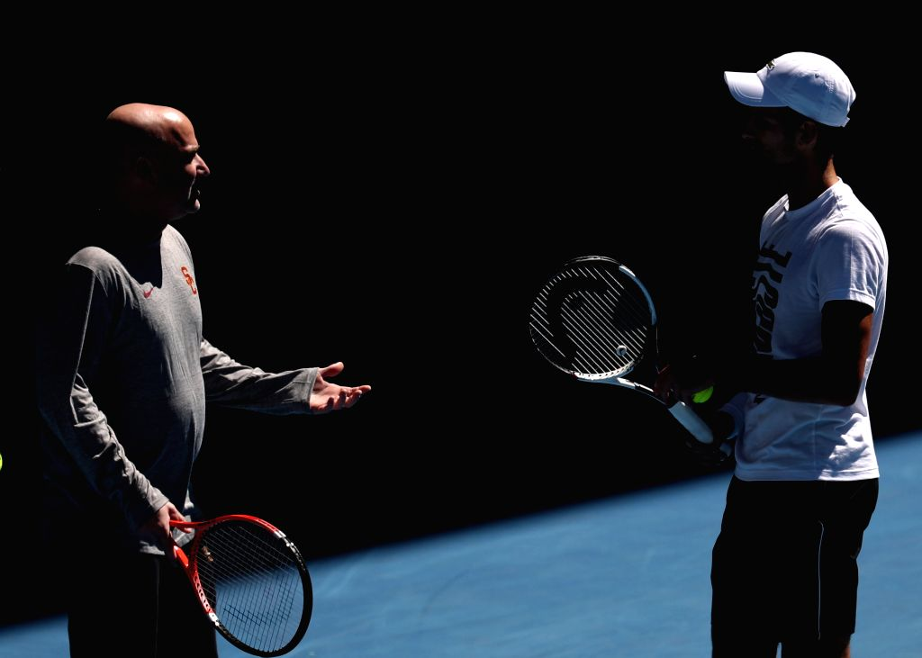 MELBOURNE, Jan. 14, 2018 - Novak Djokovic (R) of Serbia and his coach Andre Agassi of the United States chat during the training session ahead of the Australian Open 2018 at Melbourne Park in ...
