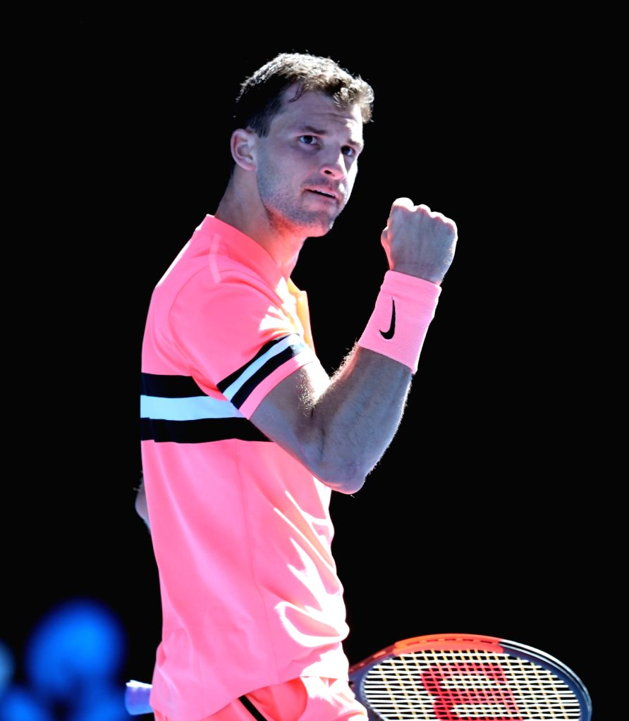 MELBOURNE, Jan. 15, 2018 - Grigor Dimitrov of Bulgaria celebrates scoring during the men's singles first round match against Dennis Novak of Austria at Australian Open 2018 in Melbourne, Australia, ...