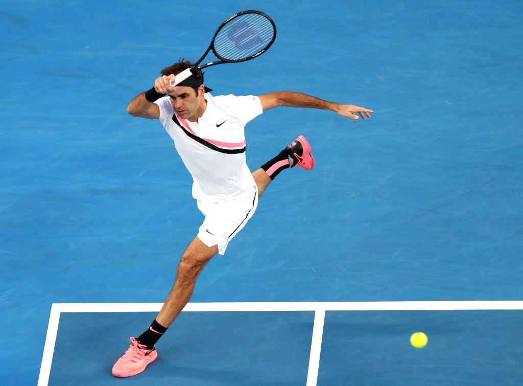 MELBOURNE, Jan. 16, 2018 - Roger Federer of Switzerland returns a shot during the men's singles first round match against Aljaz Bedene of Slovenia at the Australian Open tennis championships in ...