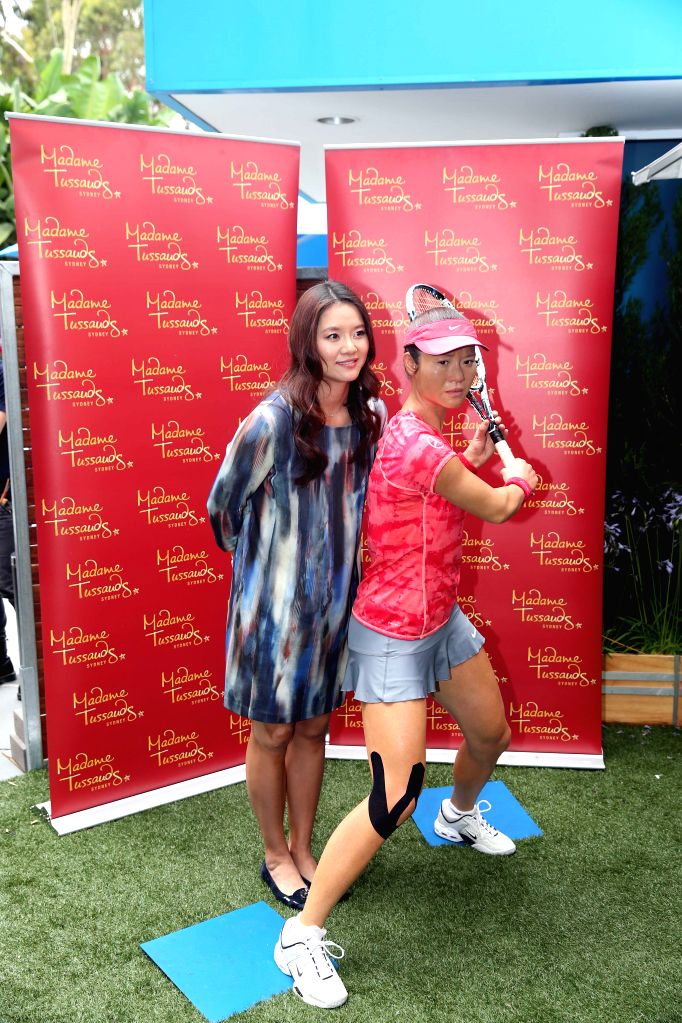 China's former tennis player Li Na poses for photos with her wax figure made by Madame Tussauds in Melbourne, Australia, Jan. 18, 2015. The unveiling ceremony of .