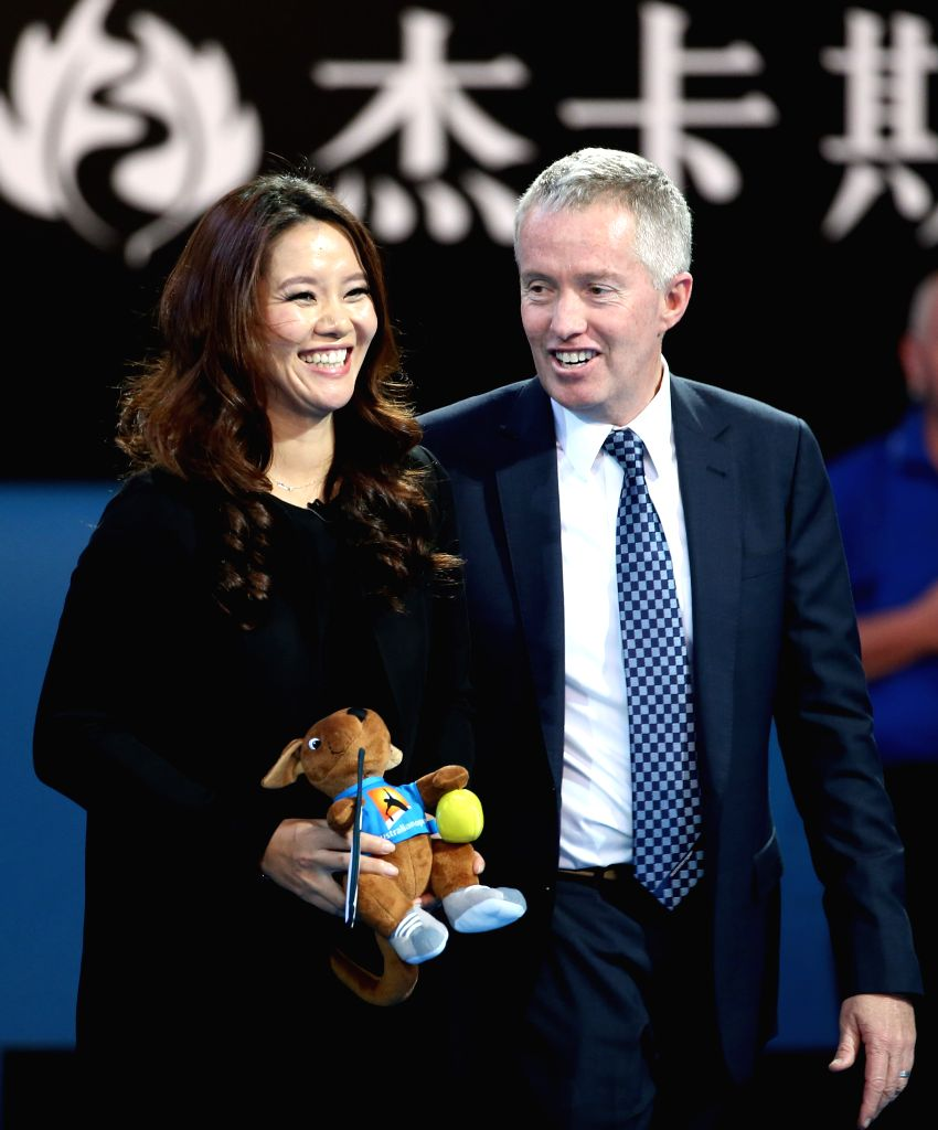 2014 Australian Open tennis champion Li Na (L) of China and Australian Open tournament director Craig Titley pose during Li Na's farewell ceremony at Rod Laver ...