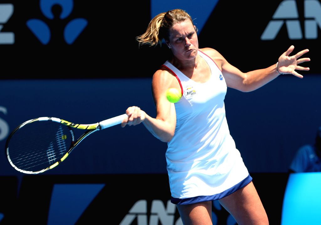 Karin Knapp of Italy hits a return during the women's singles first round match against Simona Halep of Romania at the 2015 Australian Open tennis tournament in ..
