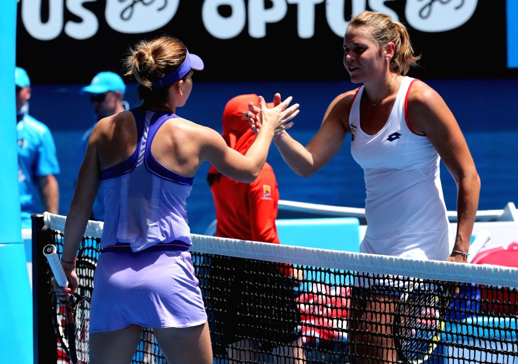 Simona Halep (L) of Romania shakes hands with Karin Knapp of Italy after the women's singles first round match at the 2015 Australian Open tennis tournament in ...