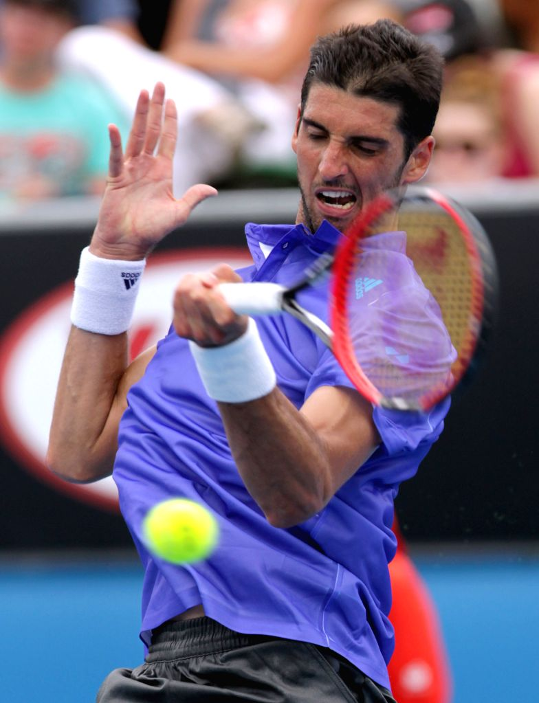 Brazil's Thomaz Bellucci returns the ball during his men's singles first round match against Spain's David Ferrer at the Australian Open tournament in Melbourne, .