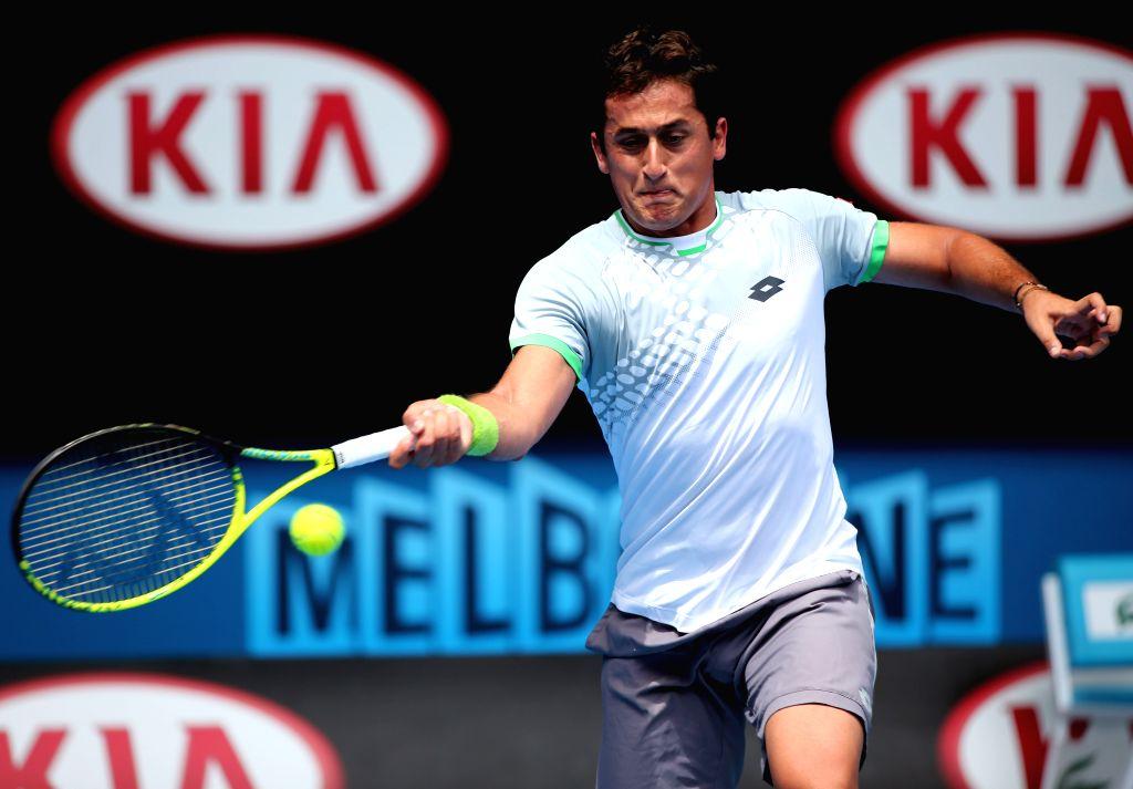 Nicolas Almagro of Spain returns the ball during the men's singles first round match against Kei Nishikori of Japan at the 2015 Australian Open tennis tournament .