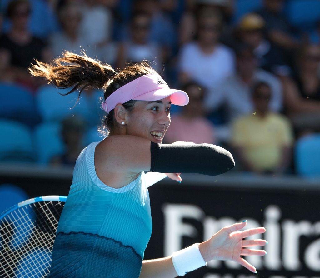 MELBOURNE, Jan. 21, 2019 - Garbine Muguruza of Spain hits a return during the women's singles 4th round match against Karolina Pliskova of the Czech Republic at the 2019 Australian Open in Melbourne, ...