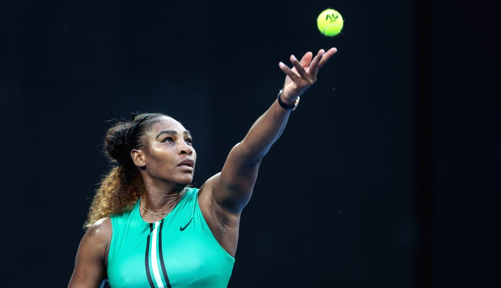 MELBOURNE, Jan. 21, 2019 - Serena Williams serves during the women's singles 4th round match between Serena Williams of the United States and Simona Halep of Romania at the 2019 Australian Open in ...