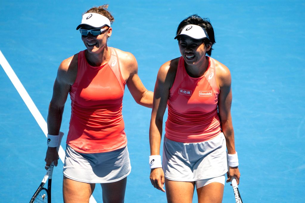 MELBOURNE, Jan. 21, 2019 - Zhang Shuai of China (R) and Samantha Stosur of Australia react during their women's doubles third round match against Alize Cornet of France and Petra Martic of Croatia at ...