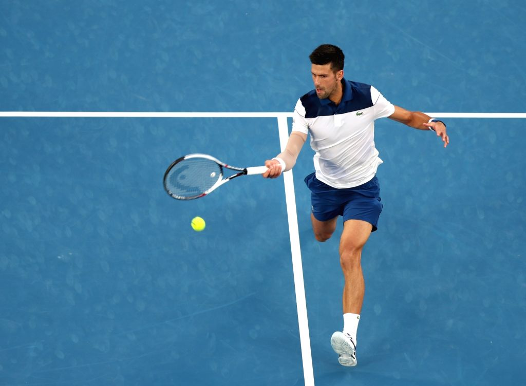 MELBOURNE, Jan. 22, 2018 - Novak Djokovic of Serbia returns a shot during the men's singles fourth round match against Chung Hyeon of South Korea at Australian Open 2018 in Melbourne, Australia, Jan. ...