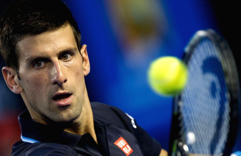 Novak Djokovic of Serbia returns the ball during the men's singles third round match against Fernando Verdasco of Spain at the 2015 Australian Open tennis ...