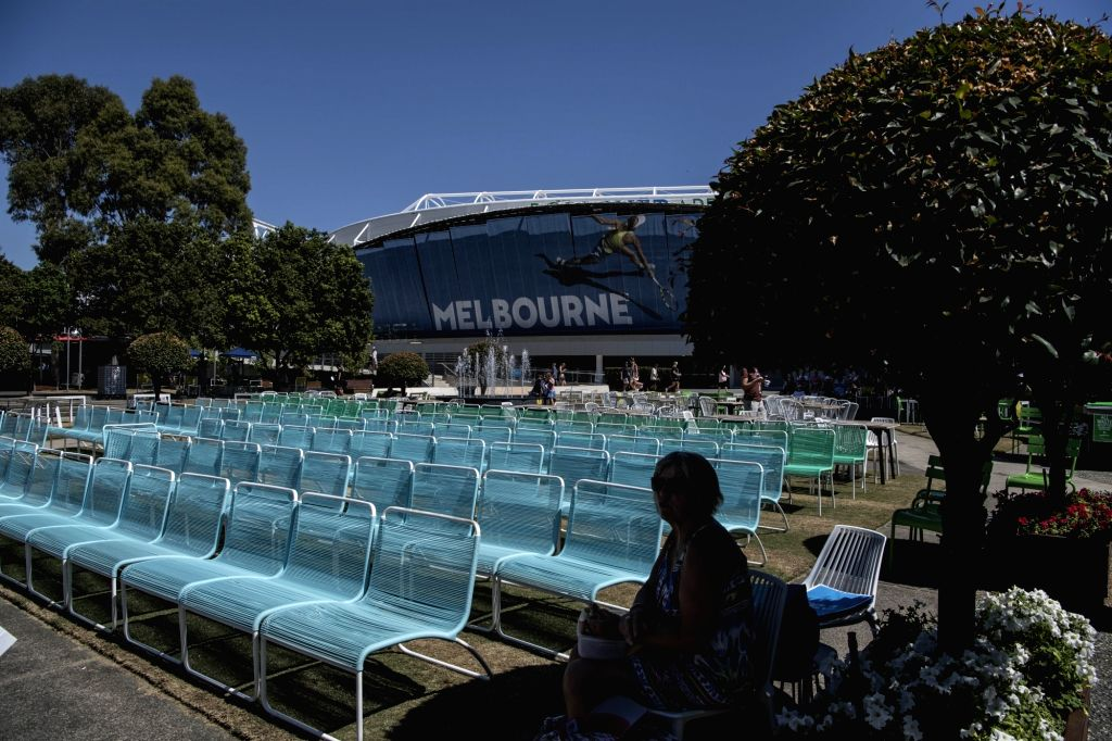 MELBOURNE, Jan. 24, 2019 - A spectator sits in the shade of a tree during the 2019 Australian Open in Melbourne, Australia, on Jan. 24, 2019. The Melbourne Park witnessed hot weather here on Thursday.