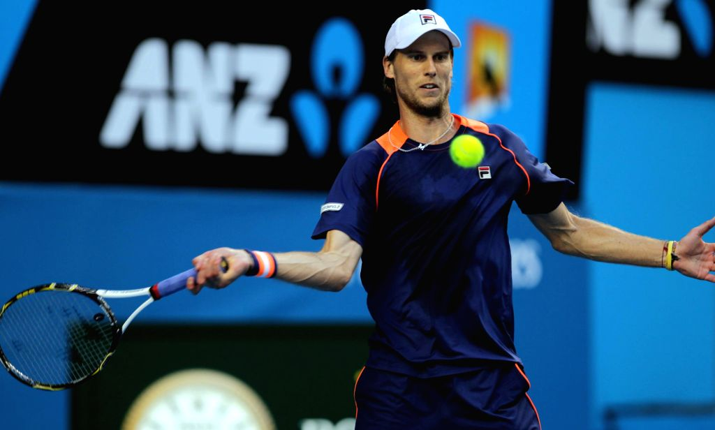 Andreas Seppi of Italy returns the ball  during his men's singles fourth round match against Nick Kyrgios of Australia on day seven of 2015 Australian Open tennis