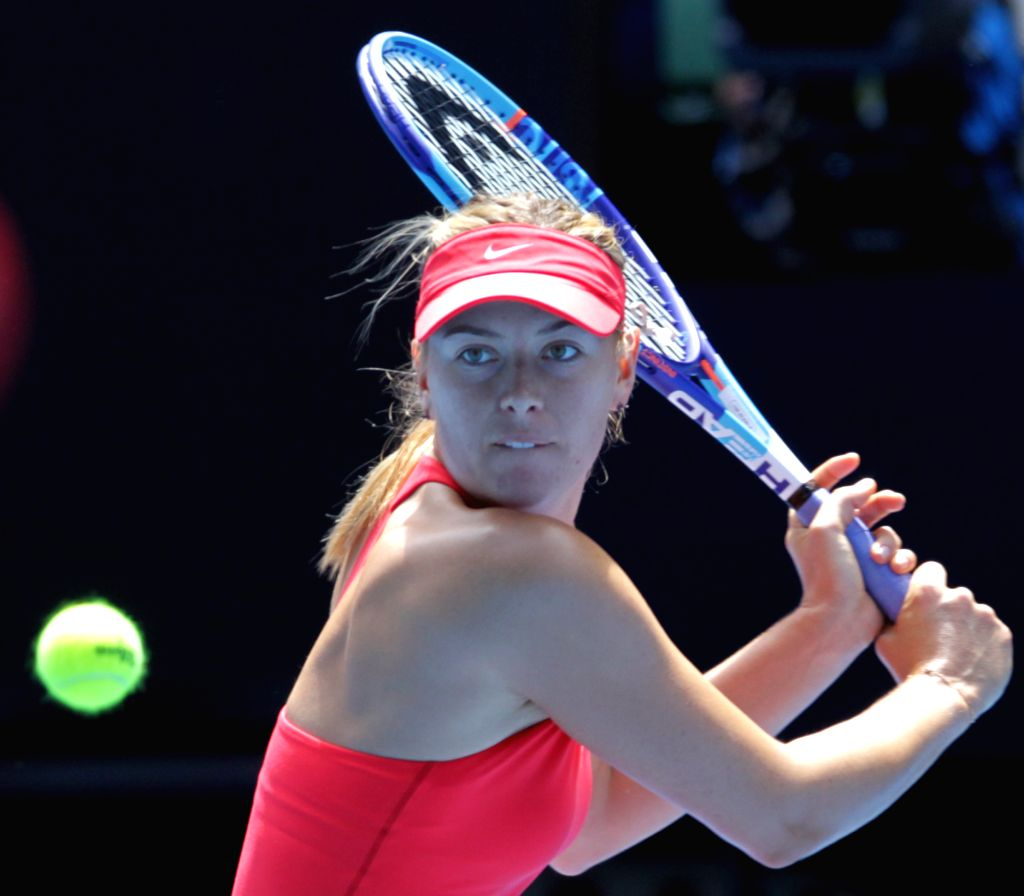 Maria Sharapova of Russia returns the ball during the women's singles fourth round match against Peng Shuai of China at the Australian Open tournament in ...