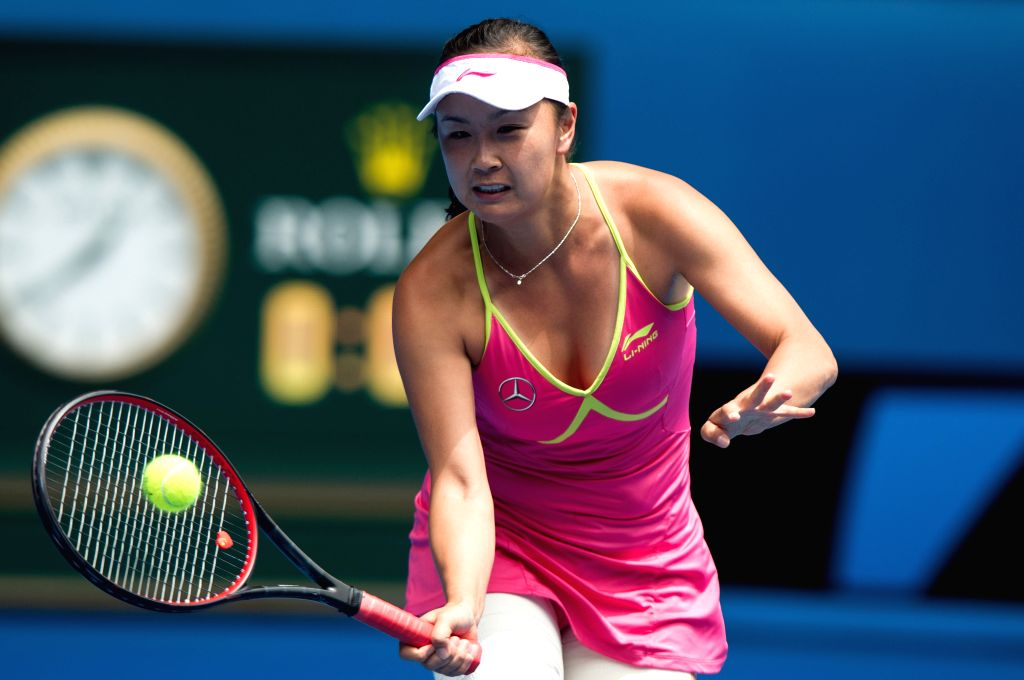Peng Shuai of China returns the ball during the women's singles fourth round match against Maria Sharapova of Russia at the Australian Open tournament in ...