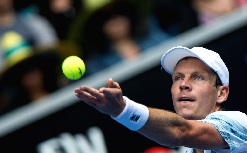 Tomas Berdych of Czech Republic serves the ball during his men's singles fourth round match against Bernard Tomic of Australia at the Australian Open tournament ..