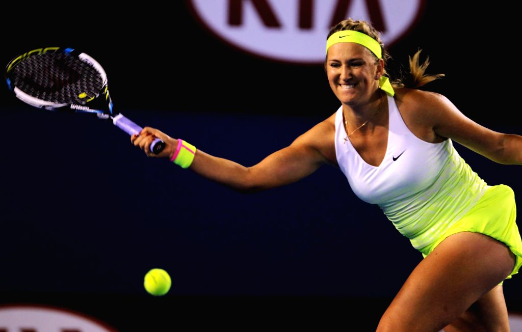 Victoria Azarenka of Belarus returns the ball during the women's singles fourth round match against Dominika Cibulkova of Slovakia at Australian Open tournament ..