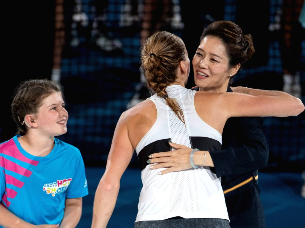 MELBOURNE, Jan. 26, 2019 - Li Na (R) of China hugs Petra Kvitova of the Czech Republic during the trophy awarding ceremony after the women's singles final match between Naomi Osaka of Japan and Petra ...